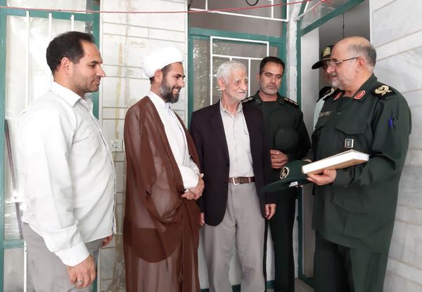 تصاویر دیدار سردار کشکولی با خانواده شهید هادیان